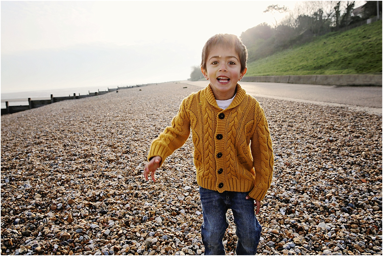 Whitstable beach photography family child early morning light boy son