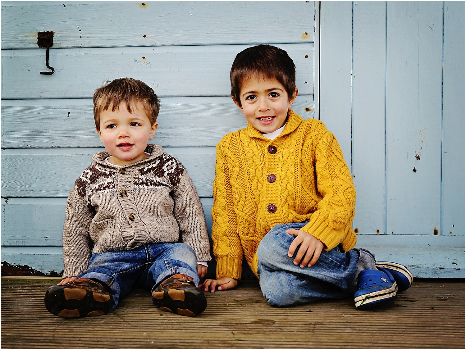 Whitstable beach photography family child boys brothers beach hut