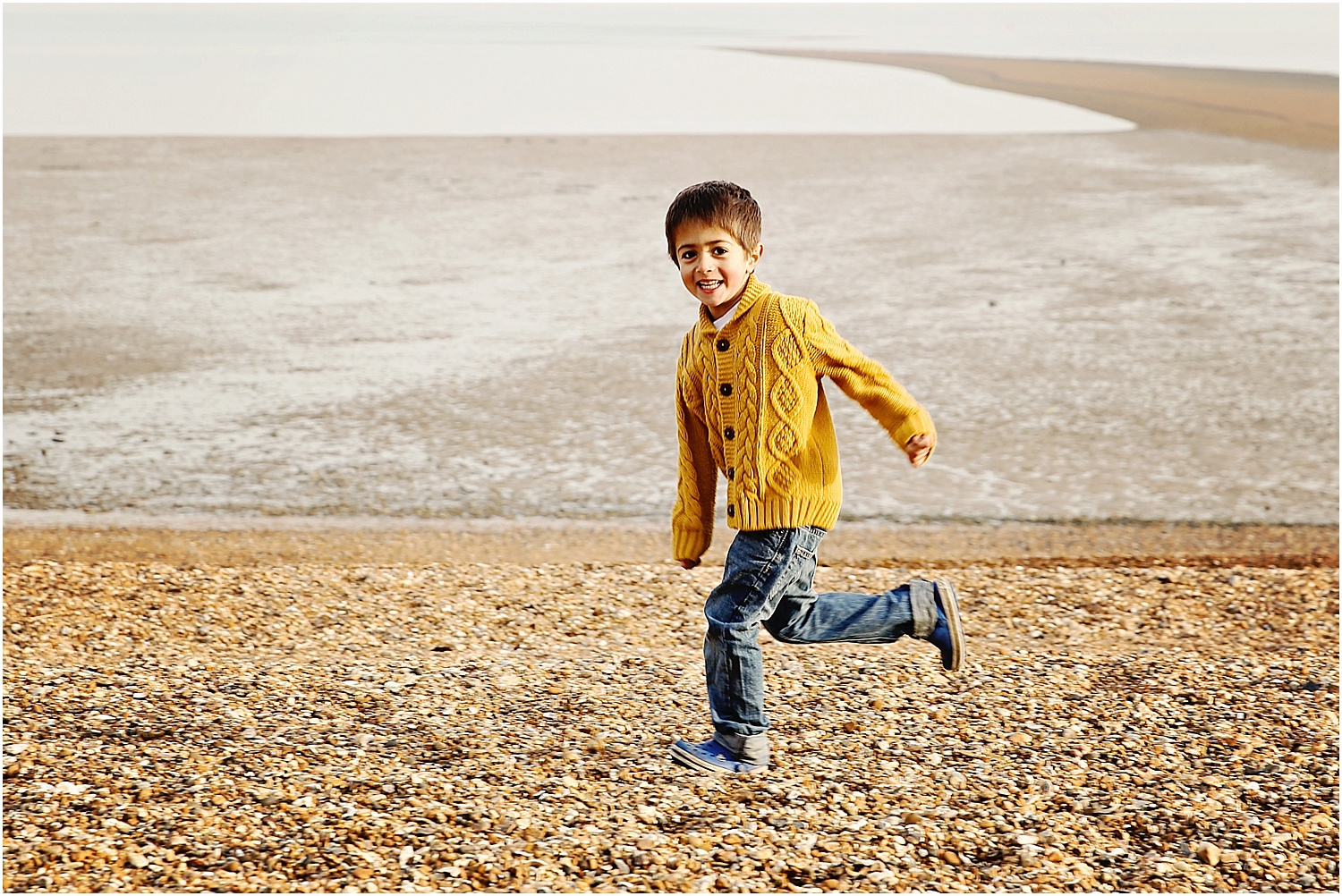 Whitstable beach photography family child boy running on beach