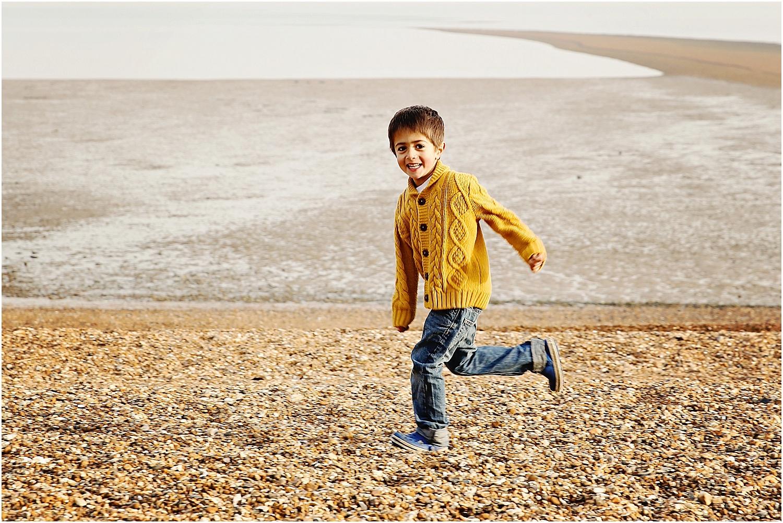 Whitstable beach photography family child boy running on beach