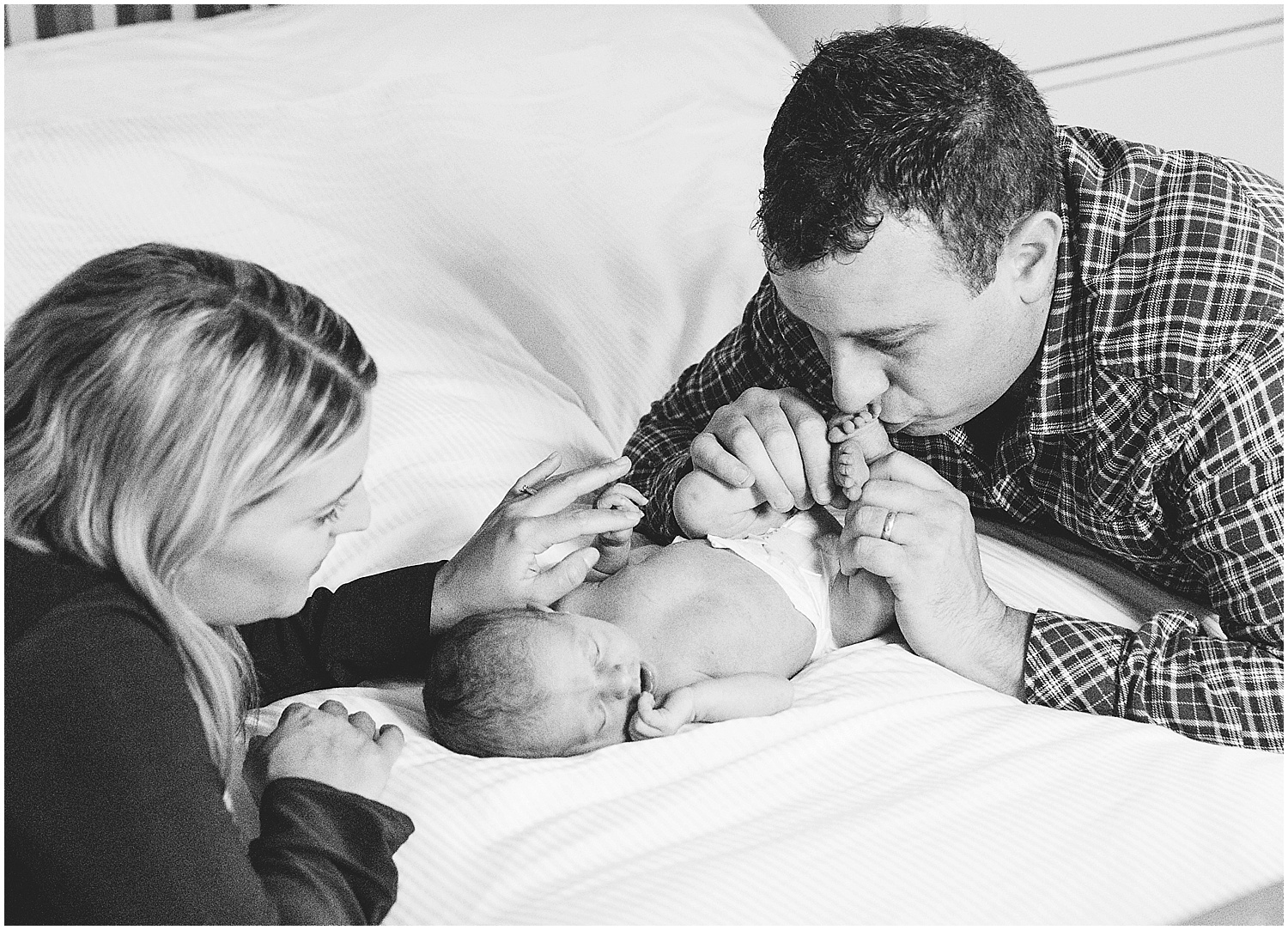 mother father and baby newborn photographer Kent