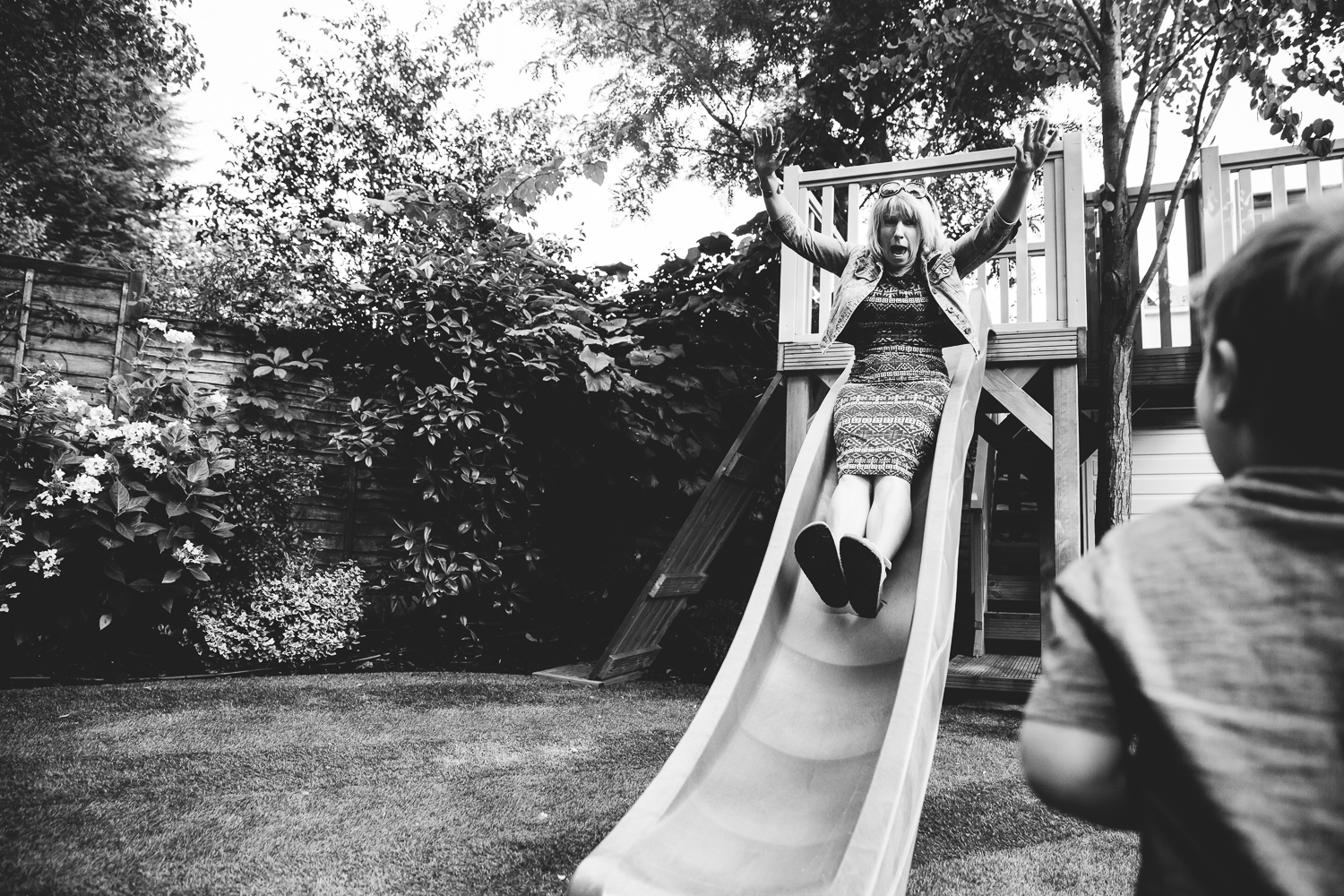 lady on slide garden birthday party photography london