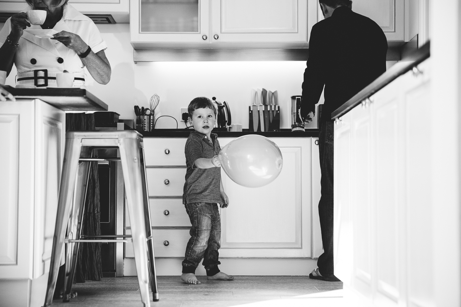 boy in kitchen with balloon photography hadley wood