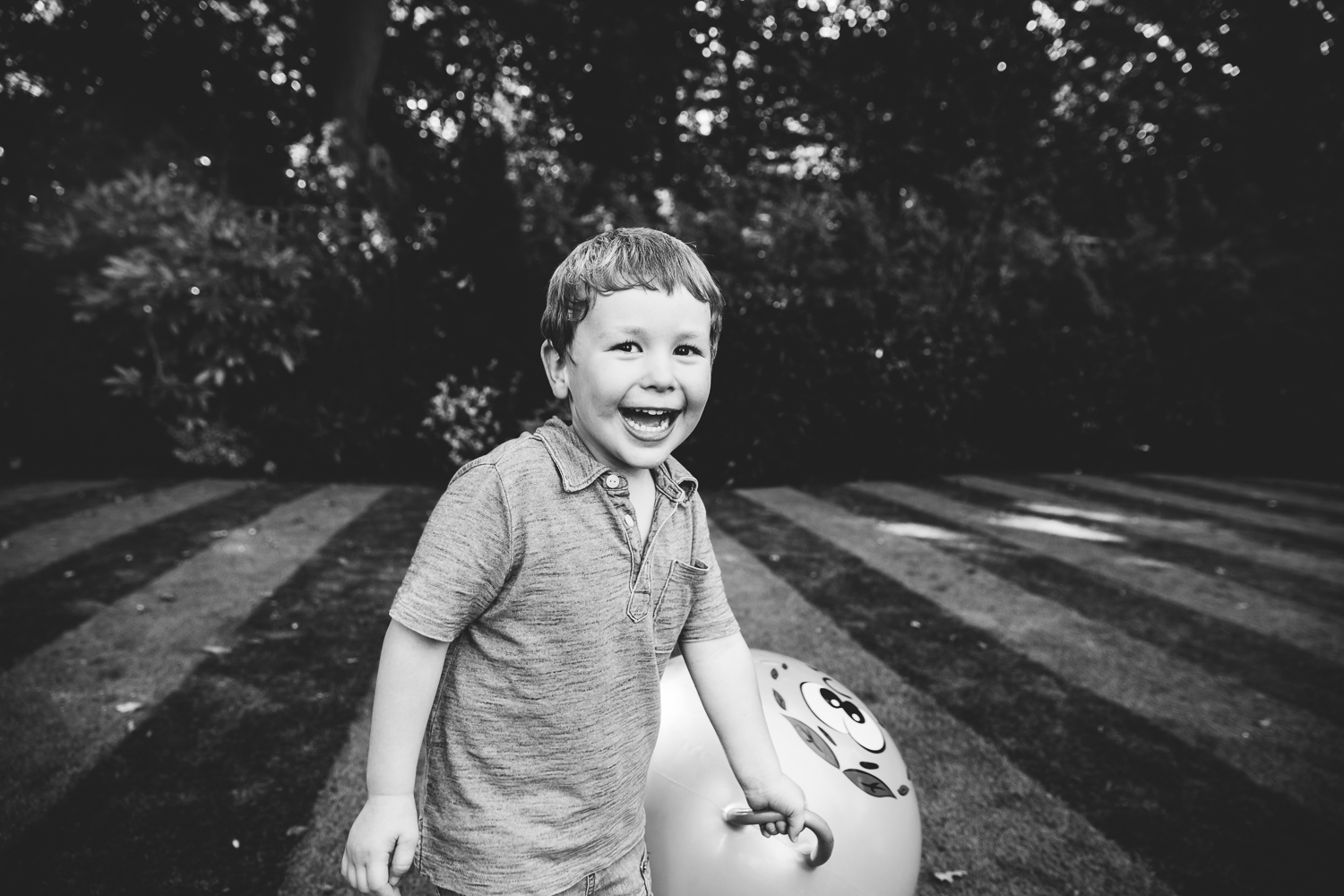 boy in garden with space hopper family photography hadley wood