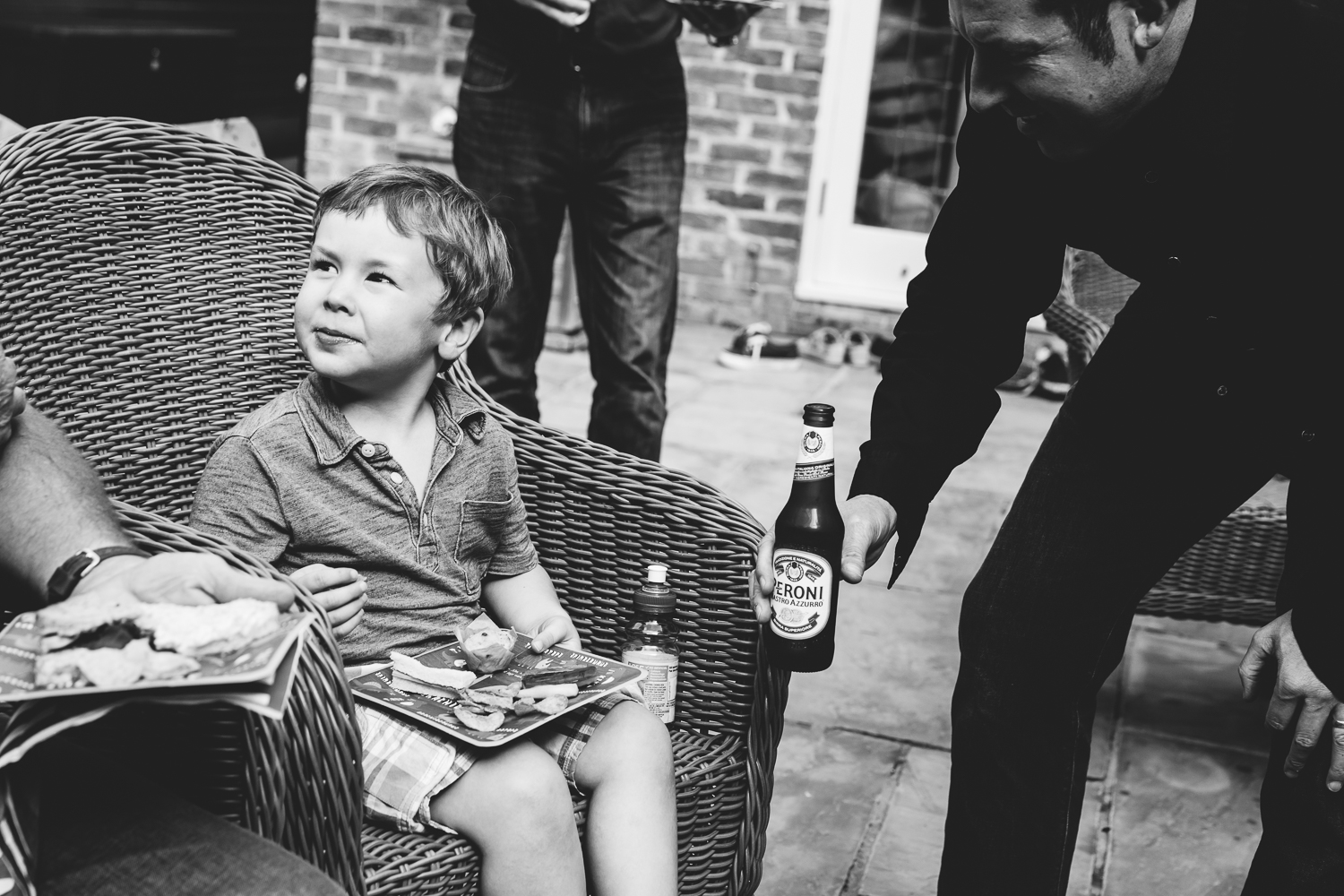 boy being offered beer funny photography in hadley wood