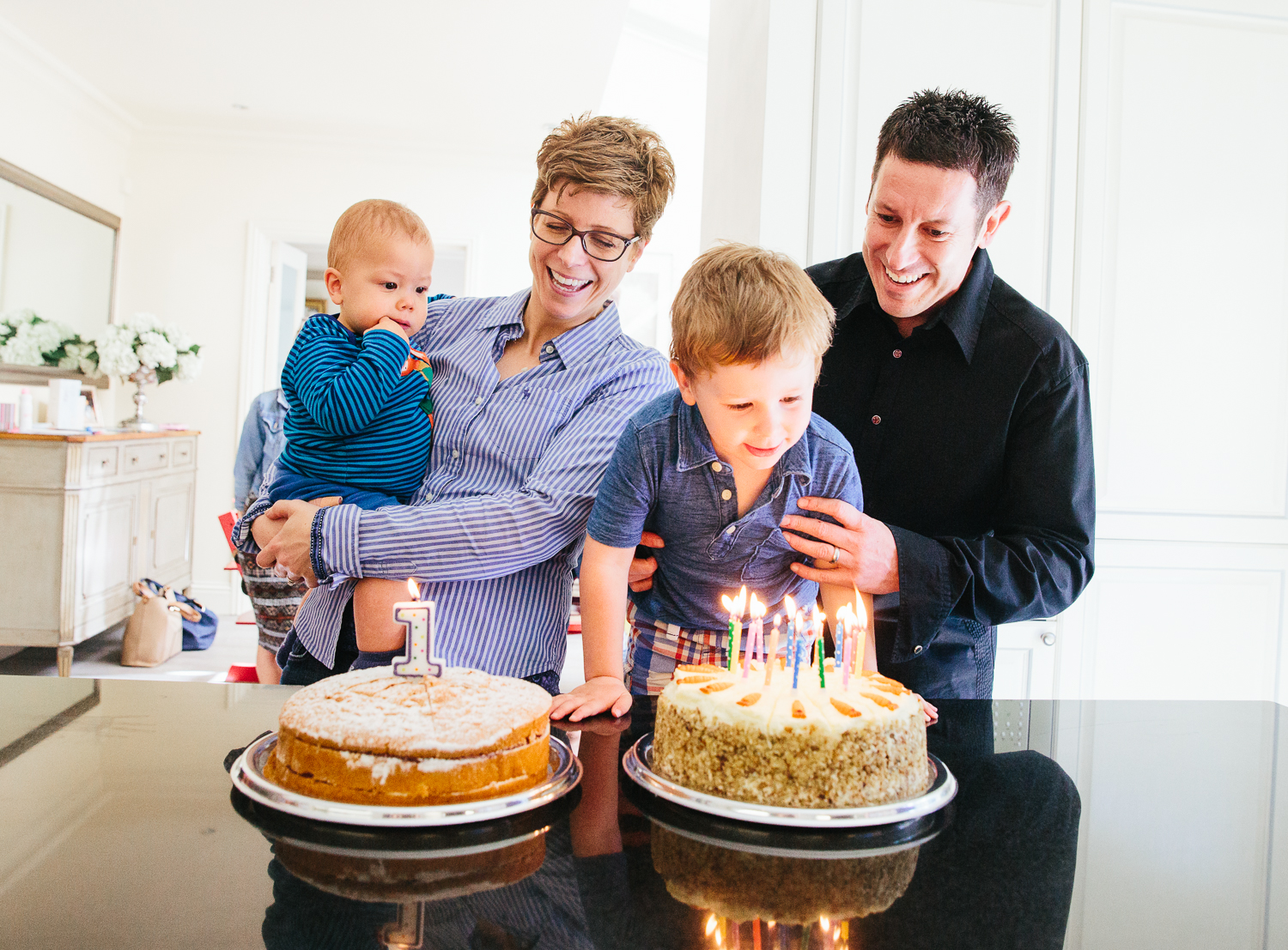 boy blowing out candles kitchen family photography hadley wood