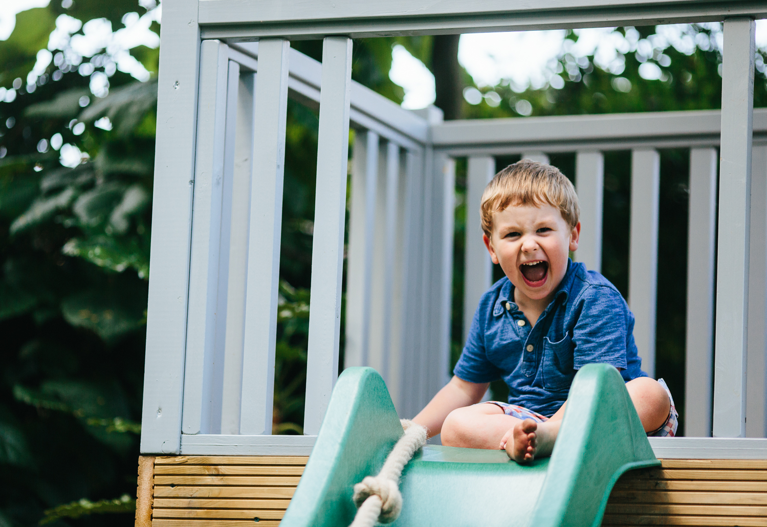 boy on slide family photography at home hadley wood london