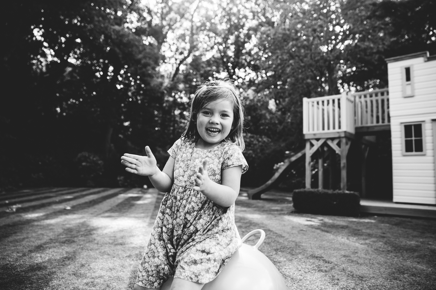 girl on space hopper garden family photography at home hadley wood london