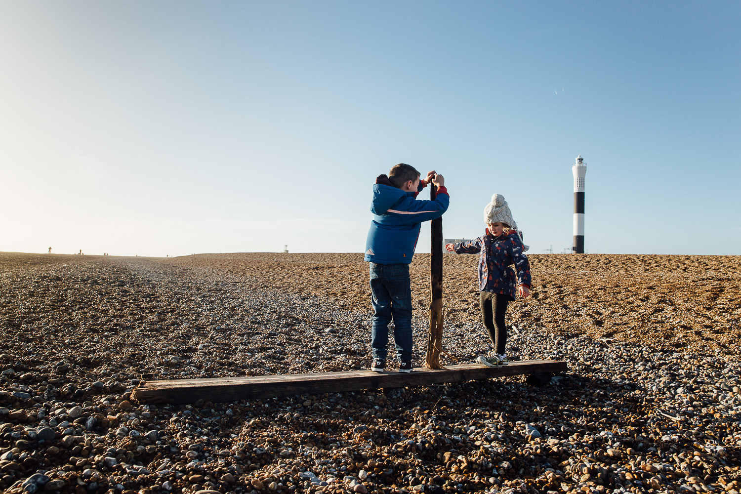 KIDS CHILDREN PLAYING ON DUNGENESS BEACH BOATS PHOTOGRAPHER FAMILY PHOTOGRAPHY LIGHTHOUSE