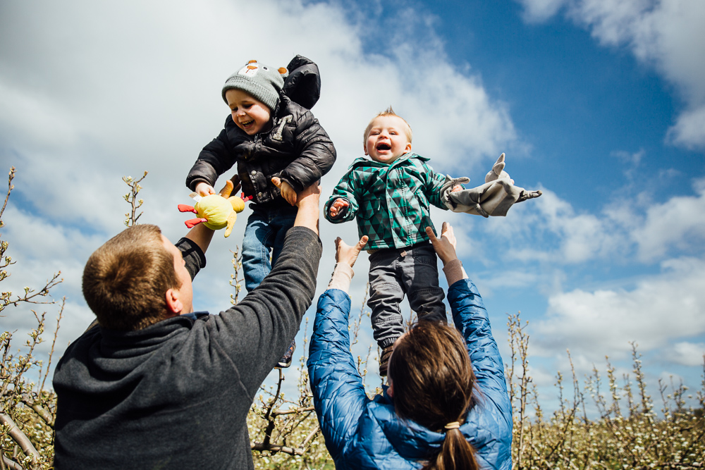 boys being thrown in air by parents playfully kent family photographer