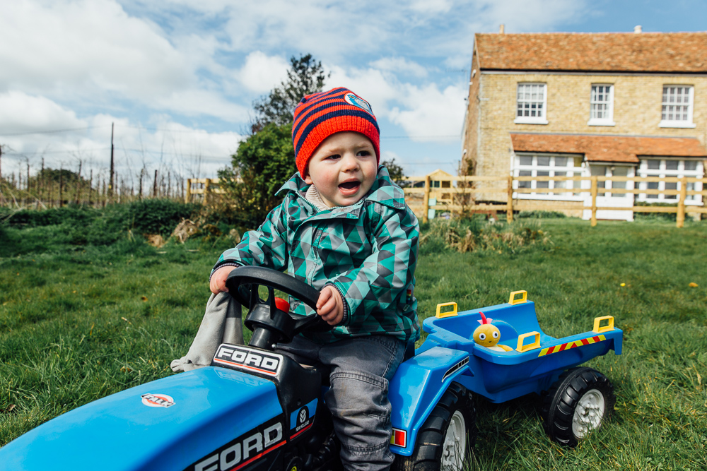 boy on tractor farm garden kent family photographer playing