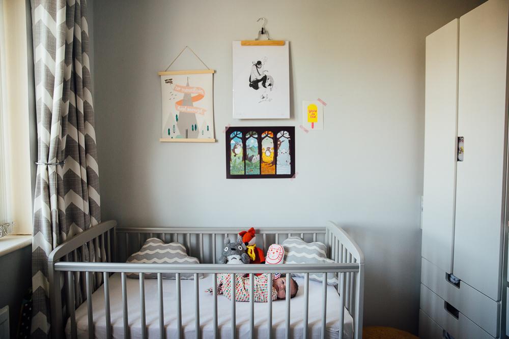 NEWBORN BABY GIRL IN COT, IN NURSERY, KENT PHOTOGRAPHER