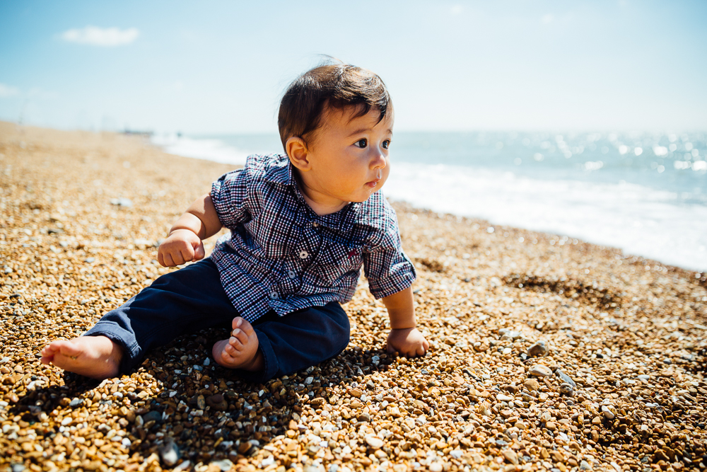 family photography of baby boy sat on beach, folkestone kent