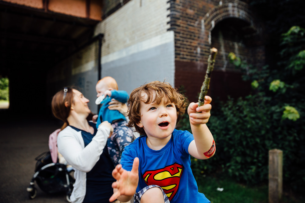BALHAM LONDON FAMILY PHOTOGRAPHY - FAMILY PORTRAIT SUPERMAN ACTION SHOT