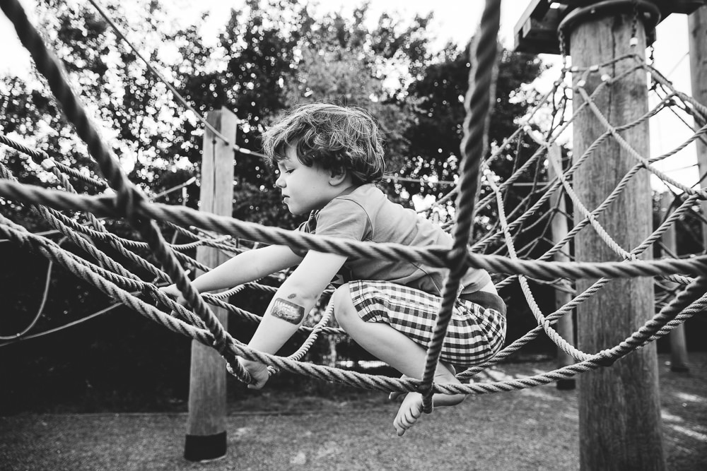 BALHAM LONDON FAMILY PHOTOGRAPHY - BOY BLACK AND WHITE PORTRAIT IN THE PLAYGROUND