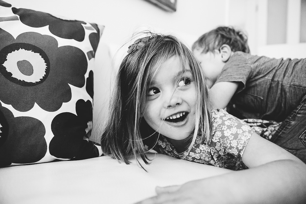 CHILDREN PLAY FIGHTING ON SOFA - KENT FAMILY PHOTOGRAPHER
