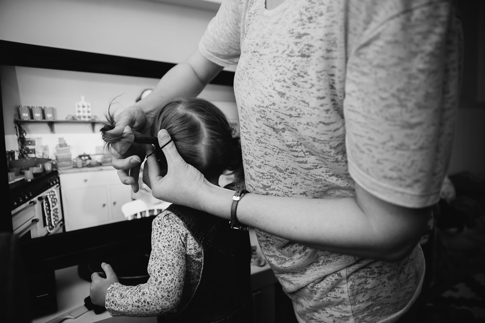 MOTHER DOING GIRLS HAIR PIGTAILS - KENT FAMILY PHOTOGRAPHER