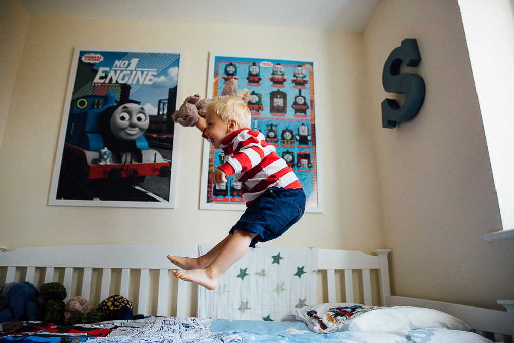 BOY JUMPING ON BED - KENT FAMILY PHOTOGRAPHER