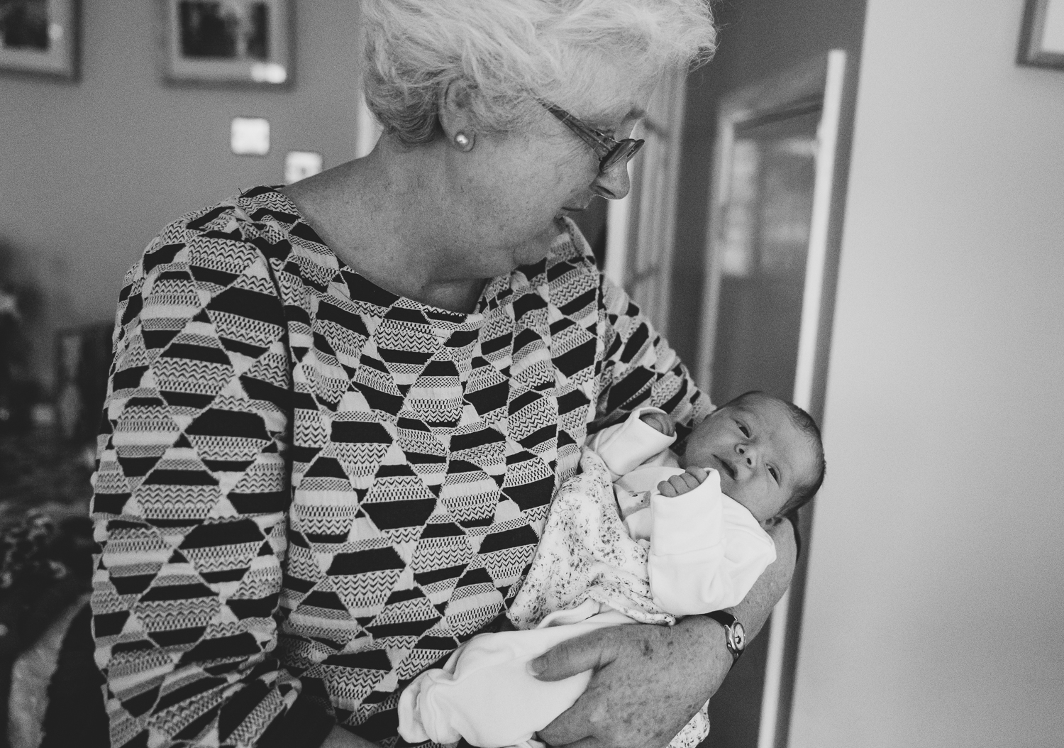 GRANDMOTHER WITH NEWBORN BABY