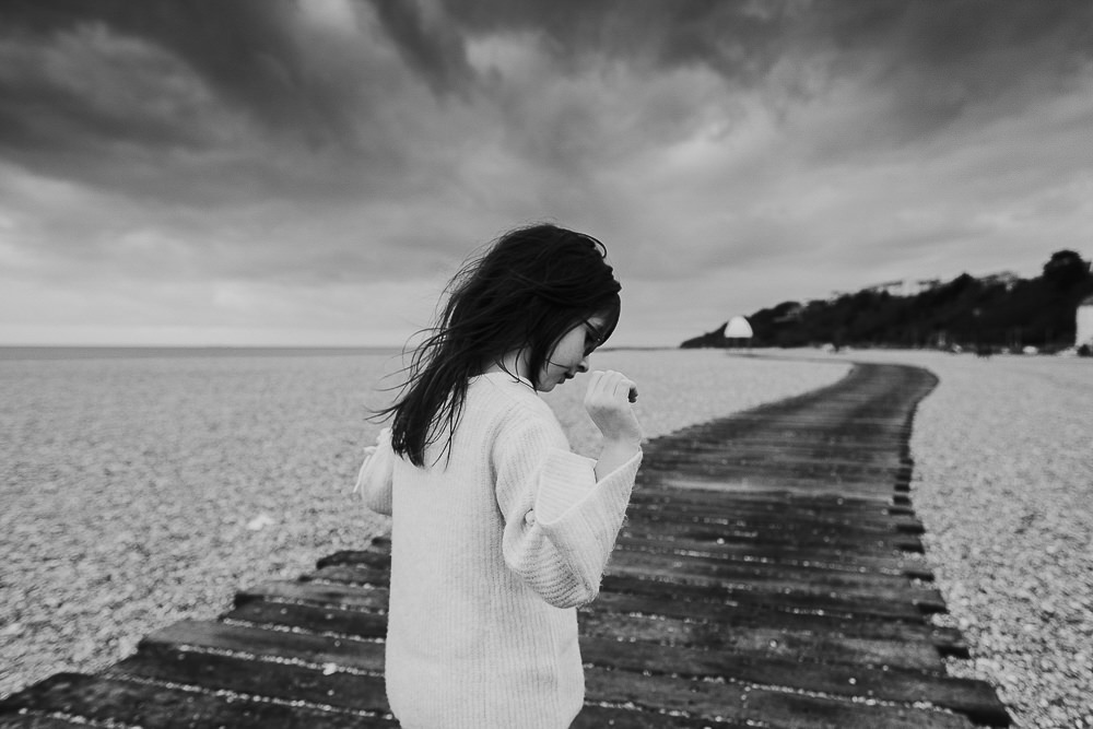 BLACK AND WHITE PHOTOGRAPH GIRL ON BEACH FOLKESTONE FAMILY PHOTOGRAPHER KENT AND LONDON