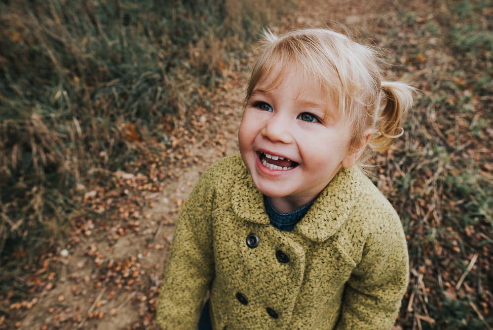 TODDLER GIRL SMILING PORTRAIT AUTUMN ASHFORD FAMILY PHOTOGRAPHER KENT AND LONDON