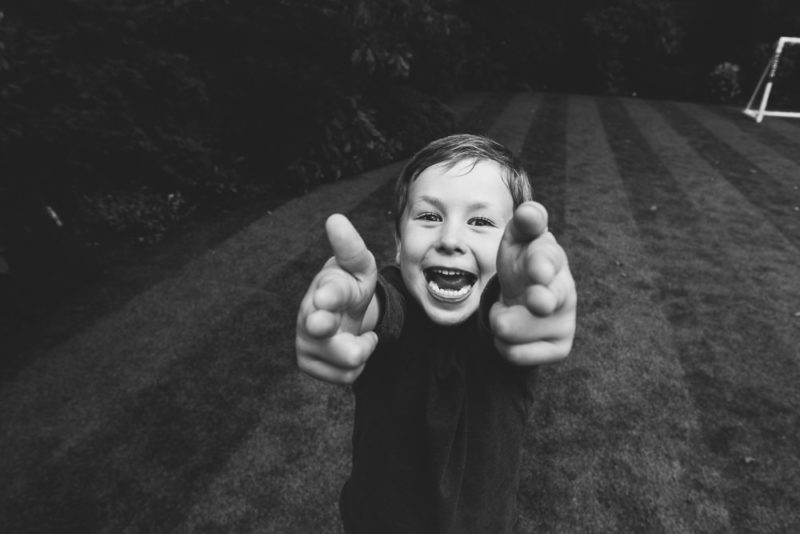 BLACK AND WHITE CHEEKY BOY GARDEN PORTRAIT HADLEY WOOD LONDON FAMILY PHOTOGRAPHER
