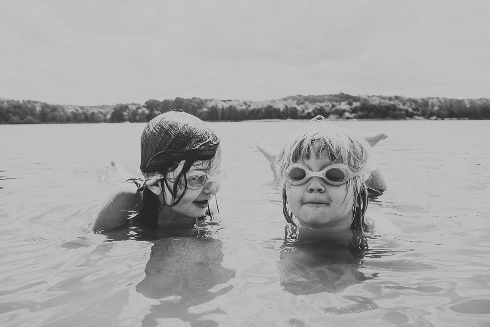 BLACK AND WHITE TWO CHILDREN IN LAKE WITH GOGGLES ON SIBLINGS FAMILY PHOTOGRAPHER KENT AND LONDON