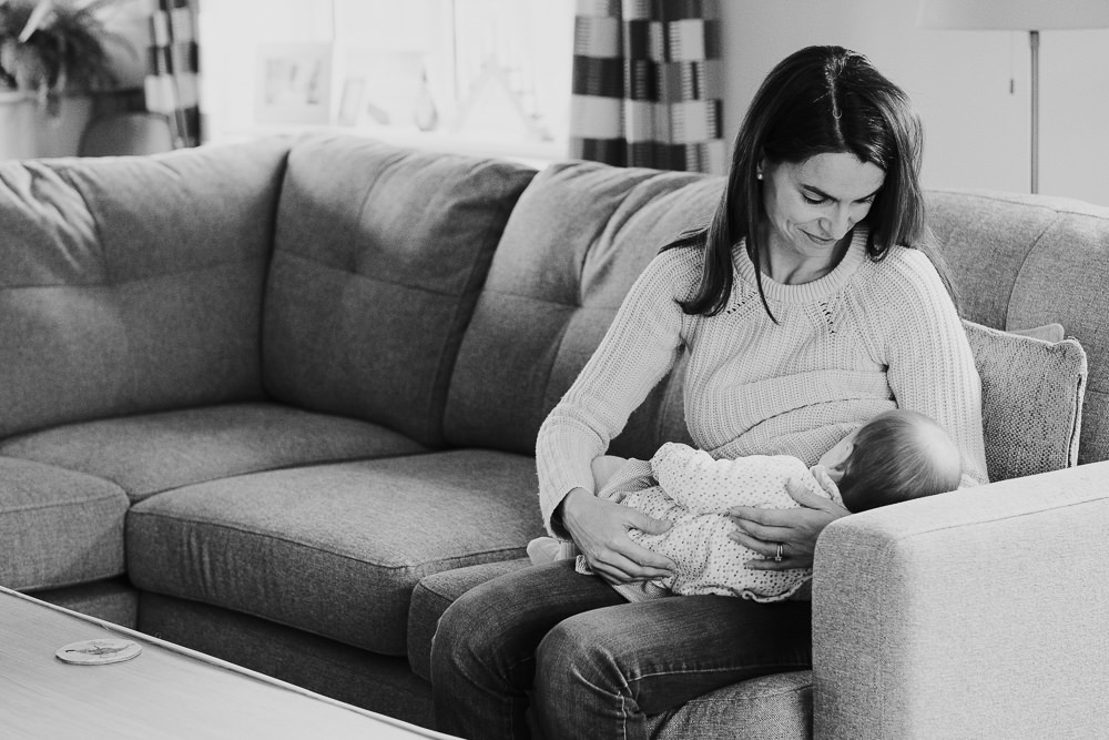 NEWBORN PHOTOGRAPHER LONDON AND KENT MOTHER BREASTFEEDING BABY BLACK AND WHITE PORTRAIT