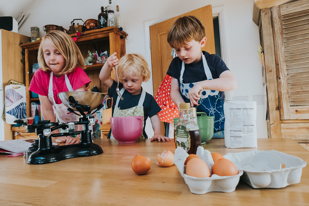 day in the life photographer children baking with eggs