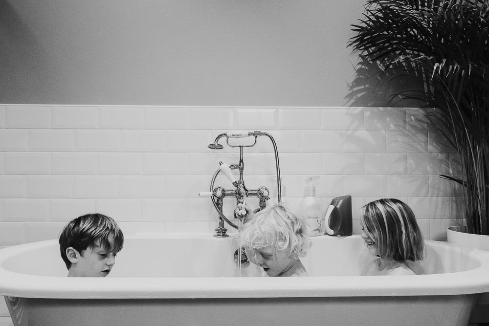 day in the life photographer small children in bath at bedtime black and white