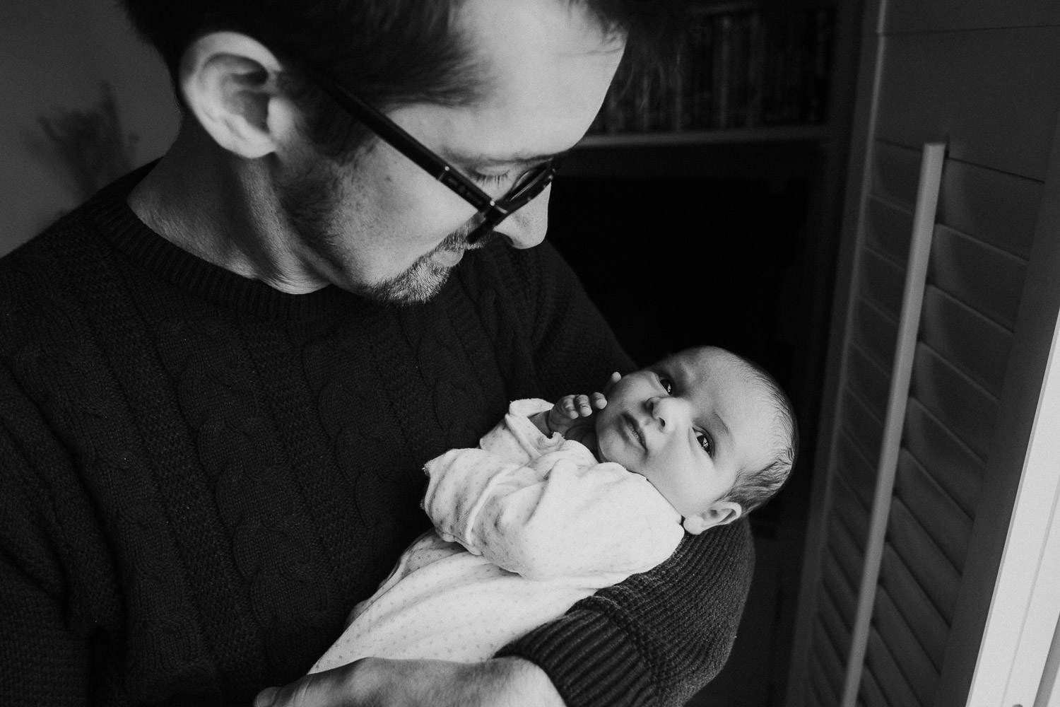 tunbridge wells baby photographer father holding newborn black and white