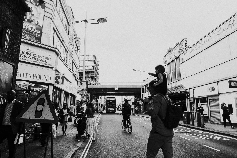 family in peckham high street black and white peckham london