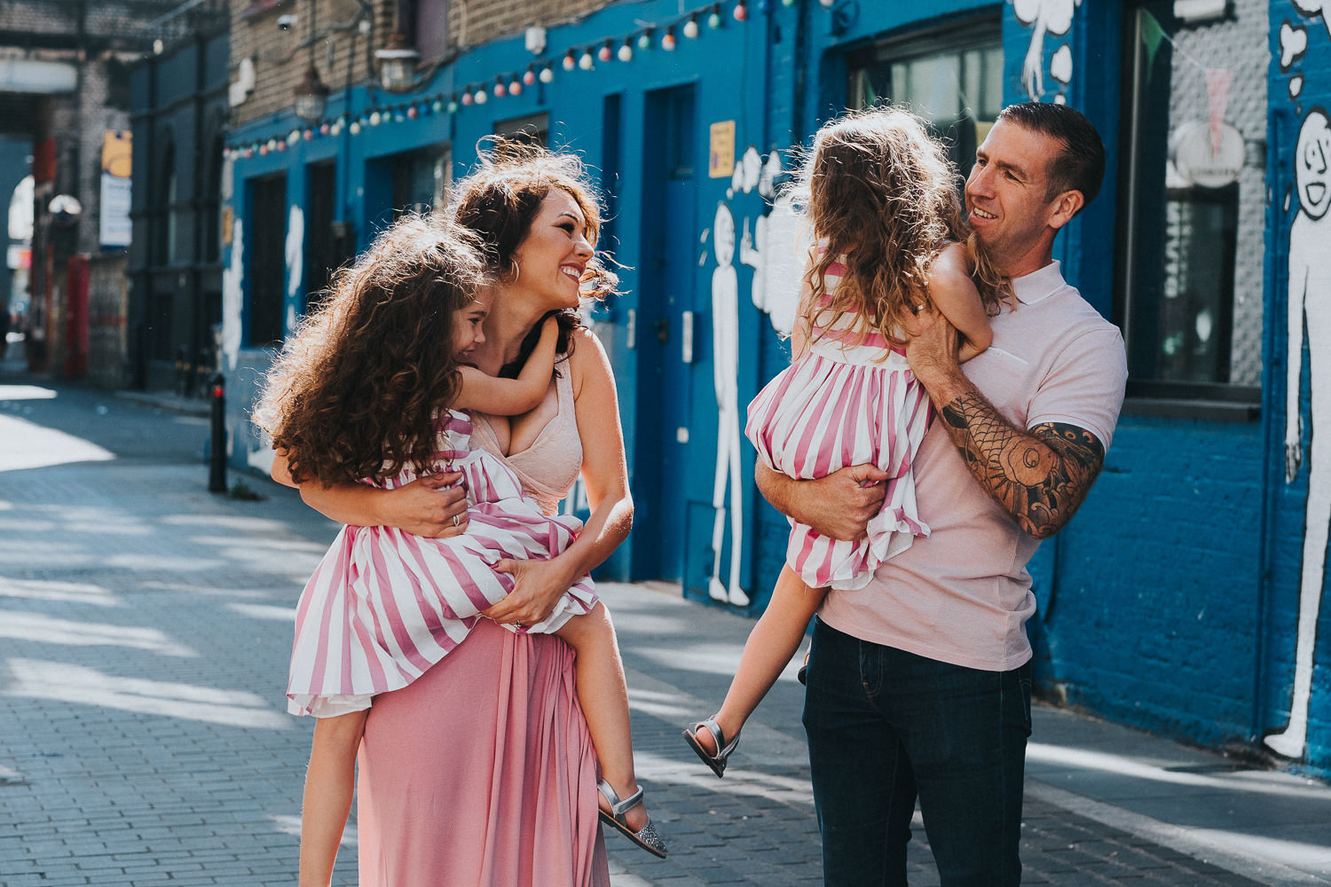 family photo shoot in shoreditch twin girls family pink dresses