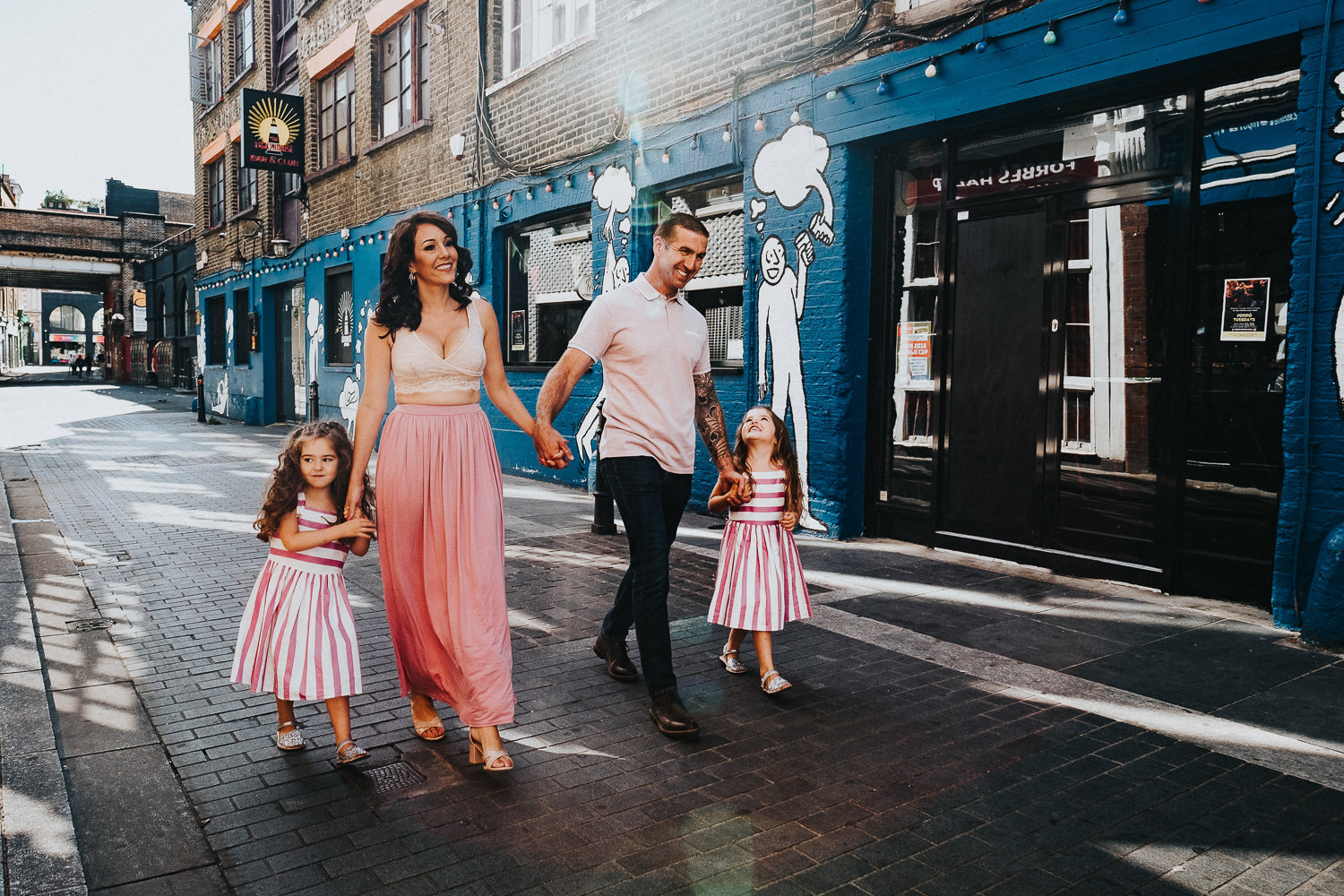 family photo shoot in shoreditch twin girls pink dresses street art