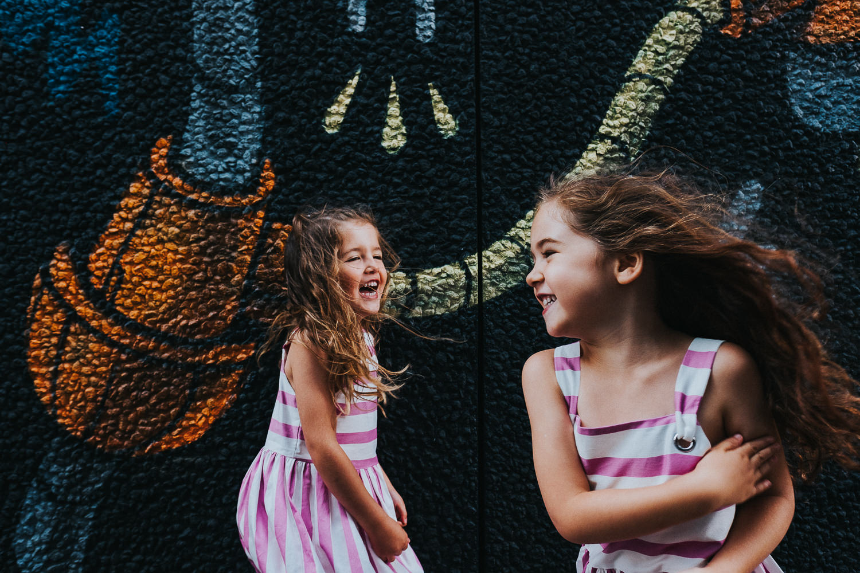 family photo shoot in shoreditch street art robot wall mural twin girls