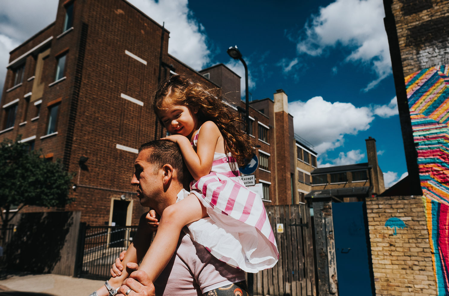family photo shoot in shoreditch street art girl on dad fathers shoulders