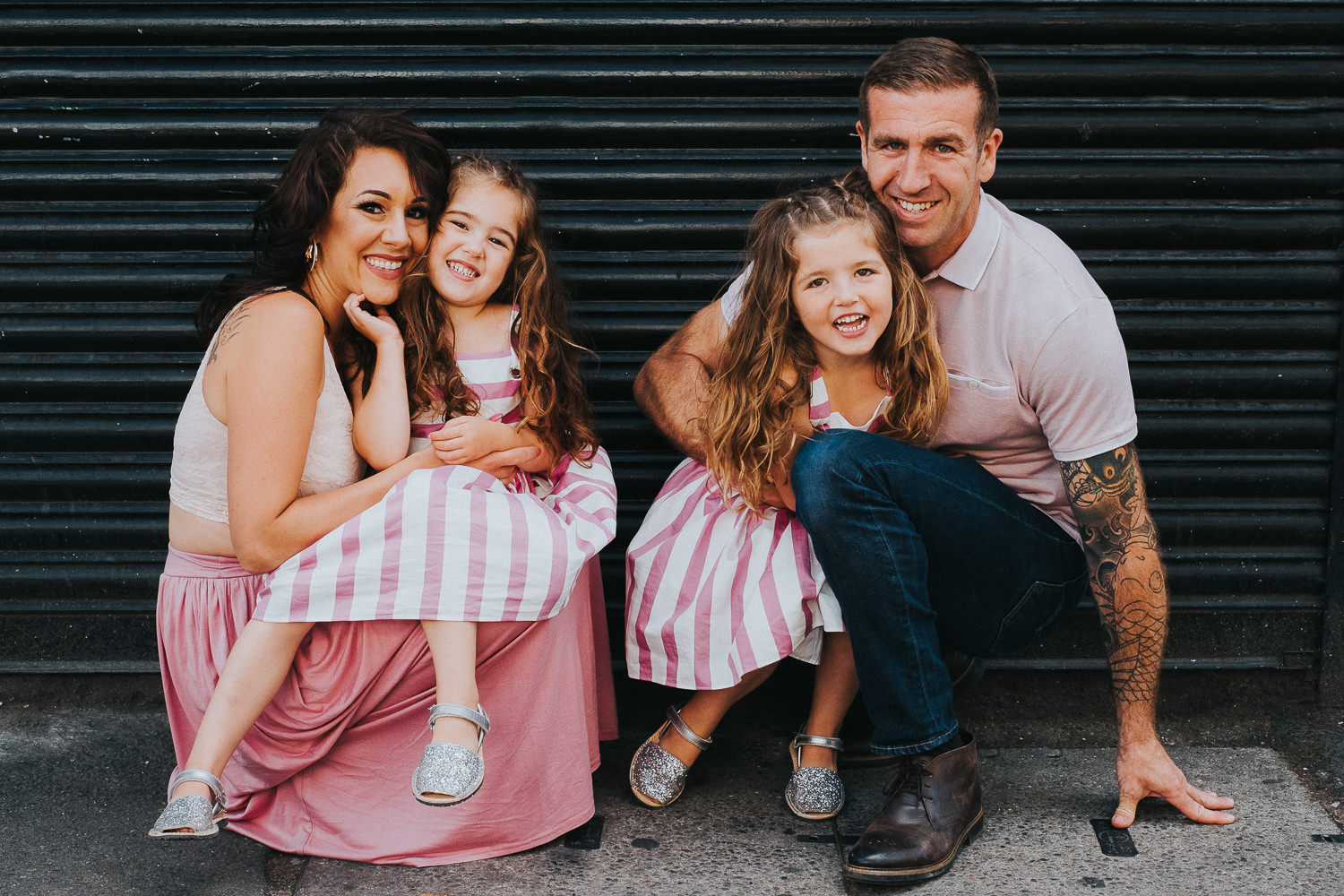 family photo shoot in shoreditch street art twin girls and parents fun portrait