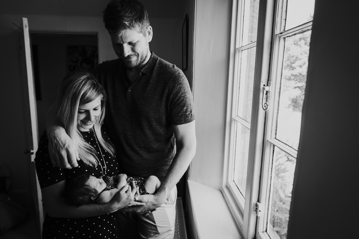 kingston baby photographer black and white photo newborn baby with parents