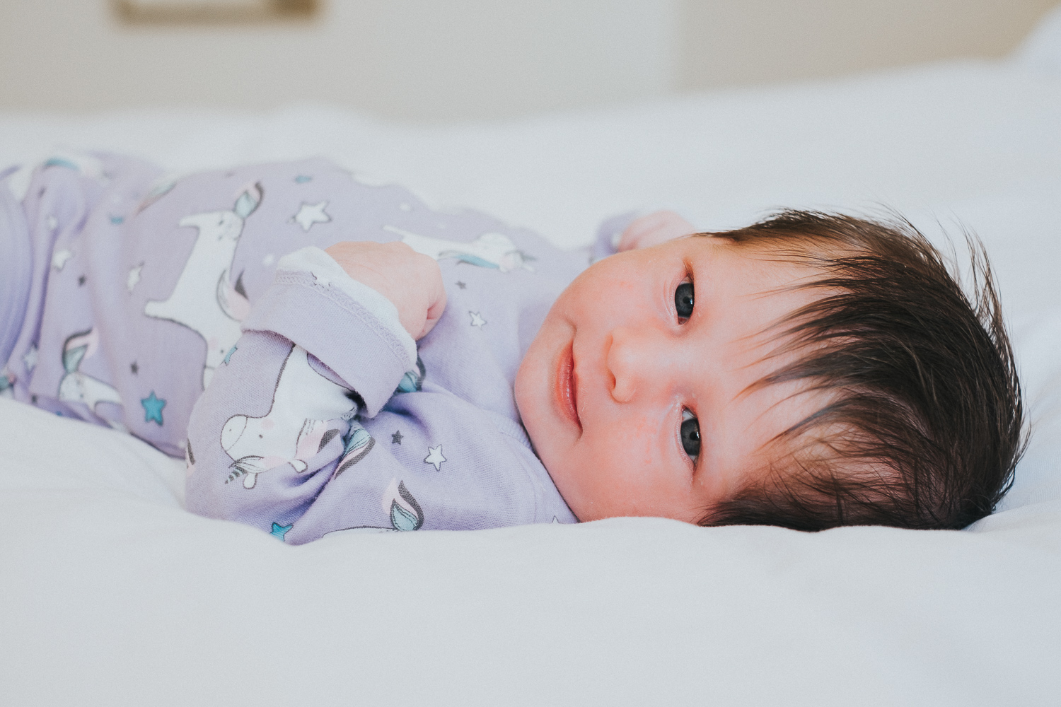 kingston baby photographer baby on bed smiling