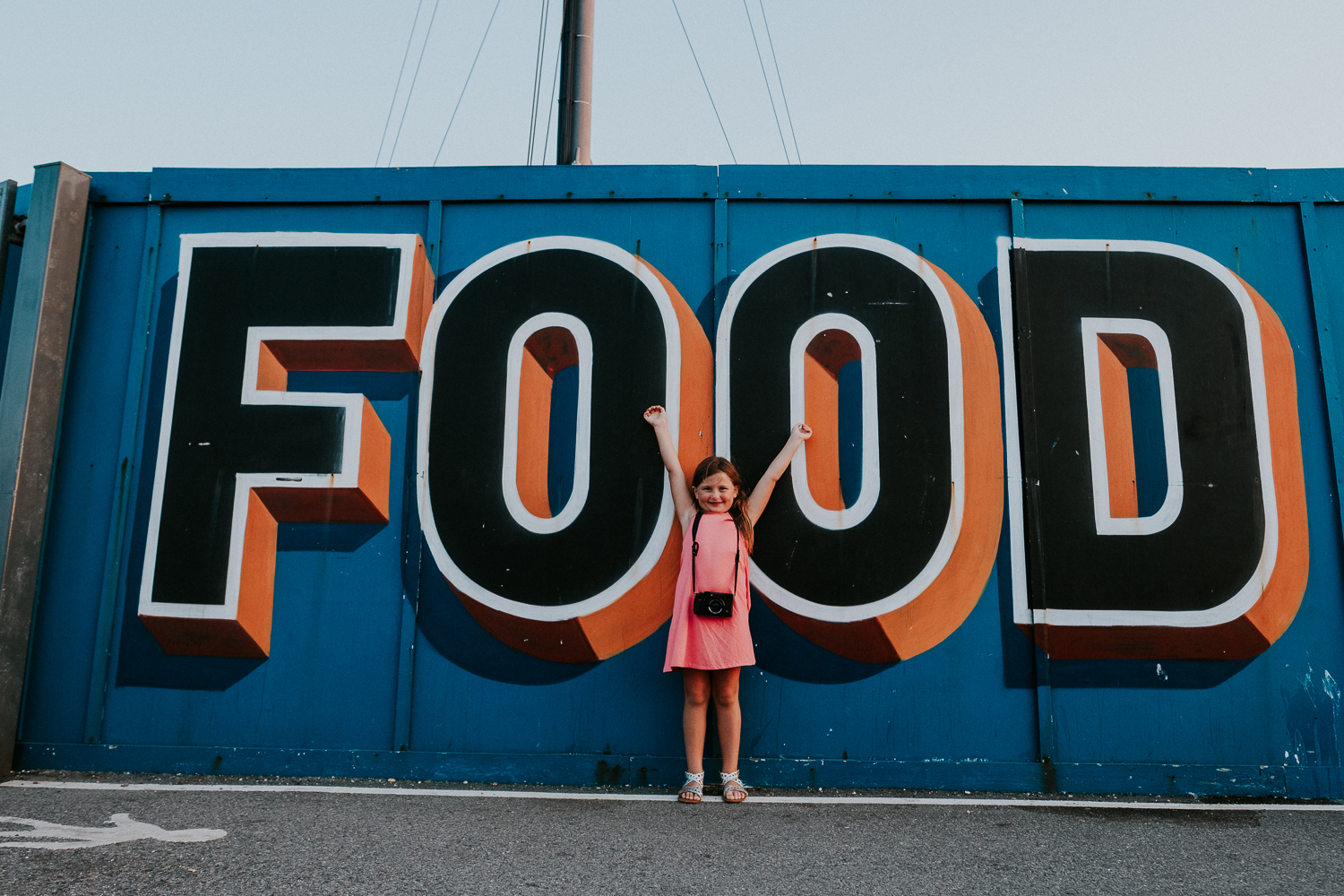 summer family photos in kent folkestone harbour arm food mural child with camera