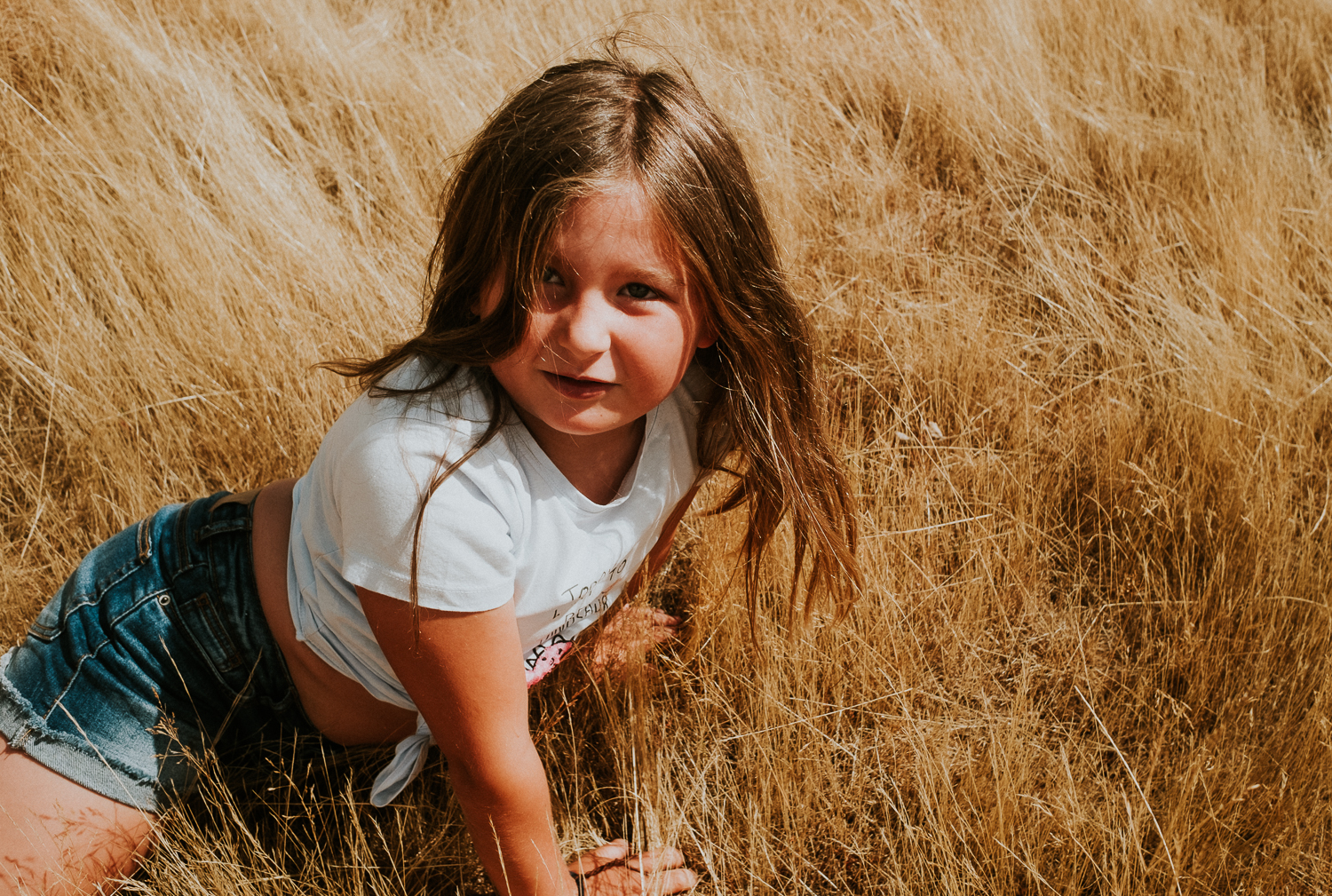 close up vibrant colour photo of seven year old girl fun summer family photos in richmond park