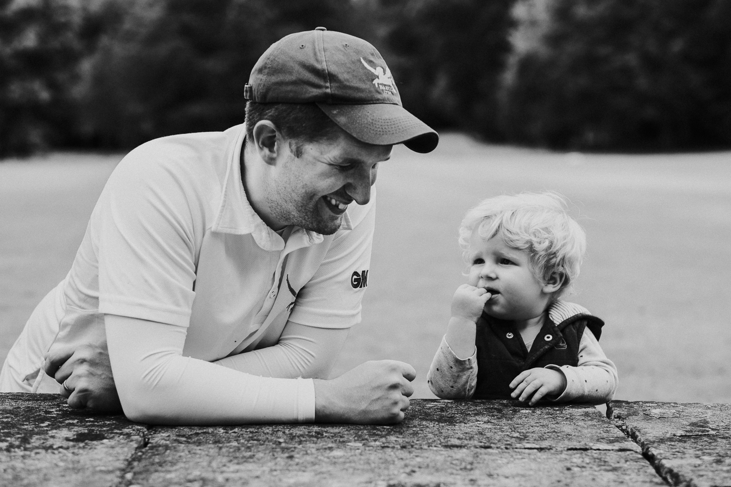 summer family photos in kent father and baby son in cricket gear at godmersham park