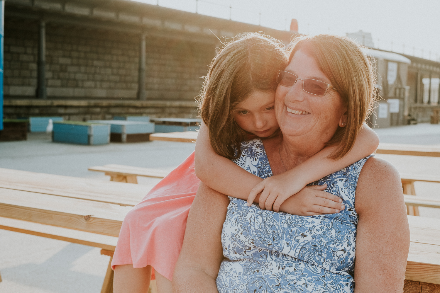 summer family photos in kent folkestone harbour arm child with grandmother