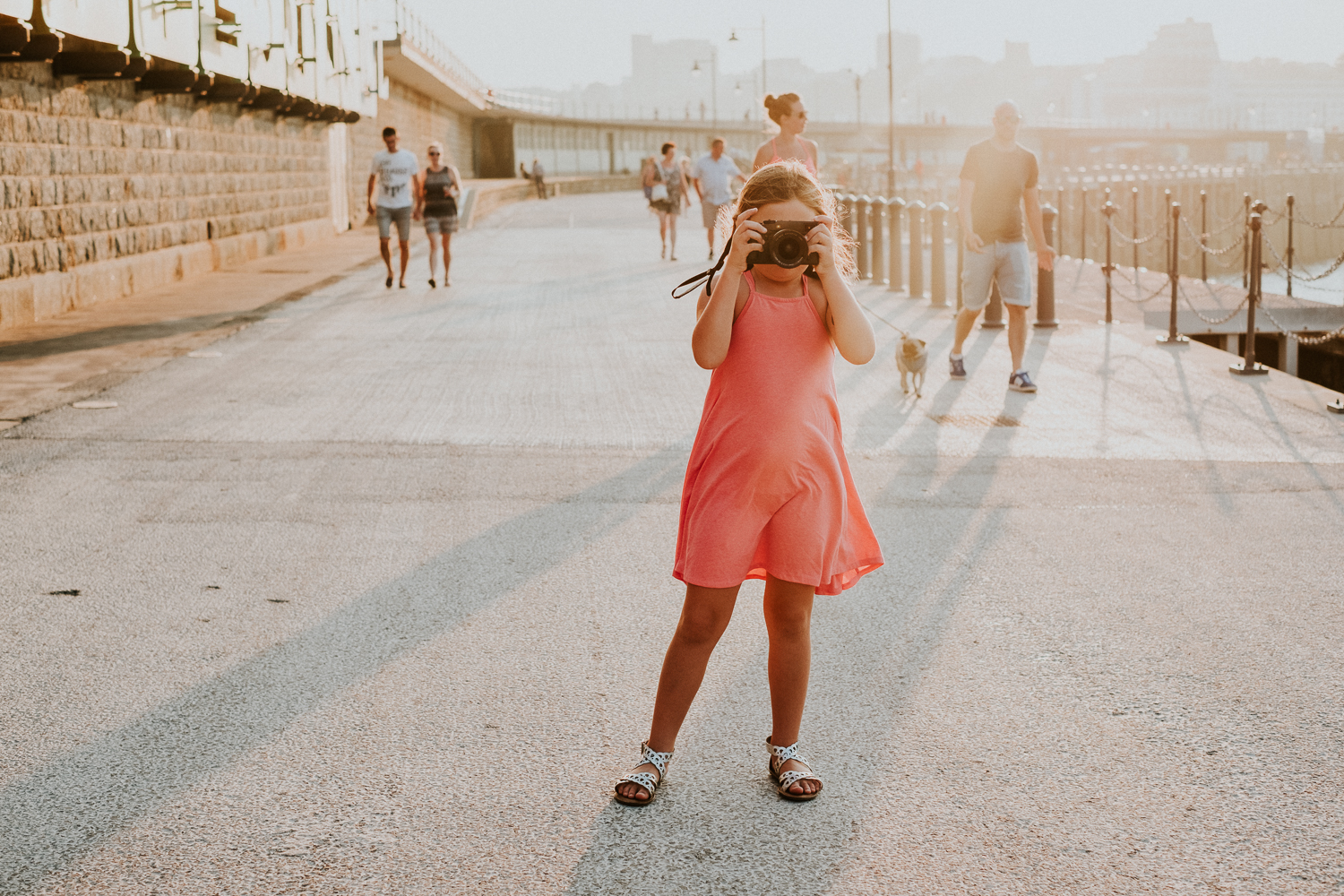 summer family photos in kent folkestone harbour arm child with camera