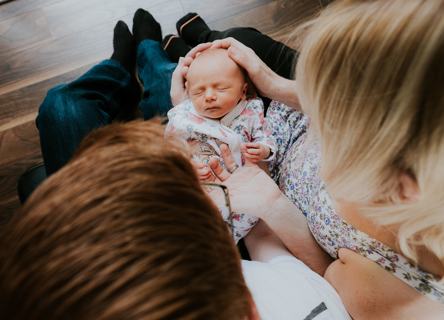 surrey lifestyle newborn photography new parents holding baby daughter