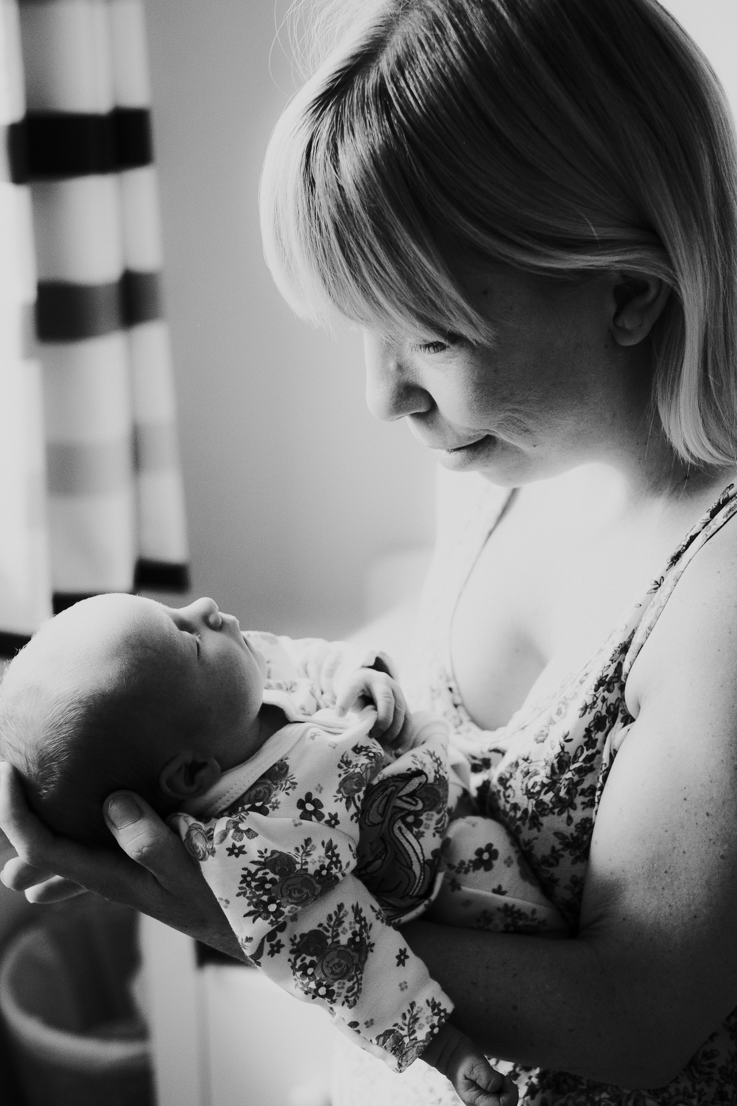 surrey lifestyle newborn photography mother holding baby daughter