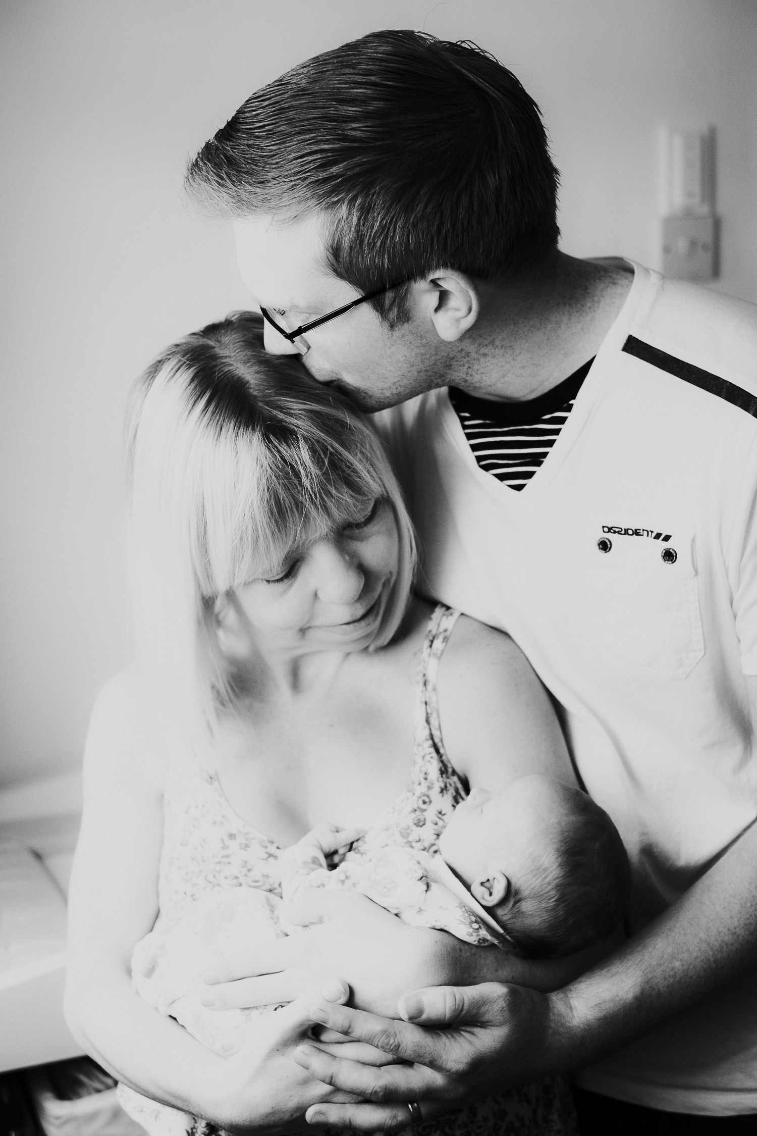 surrey lifestyle newborn photography new parents holding baby daughter in nursery