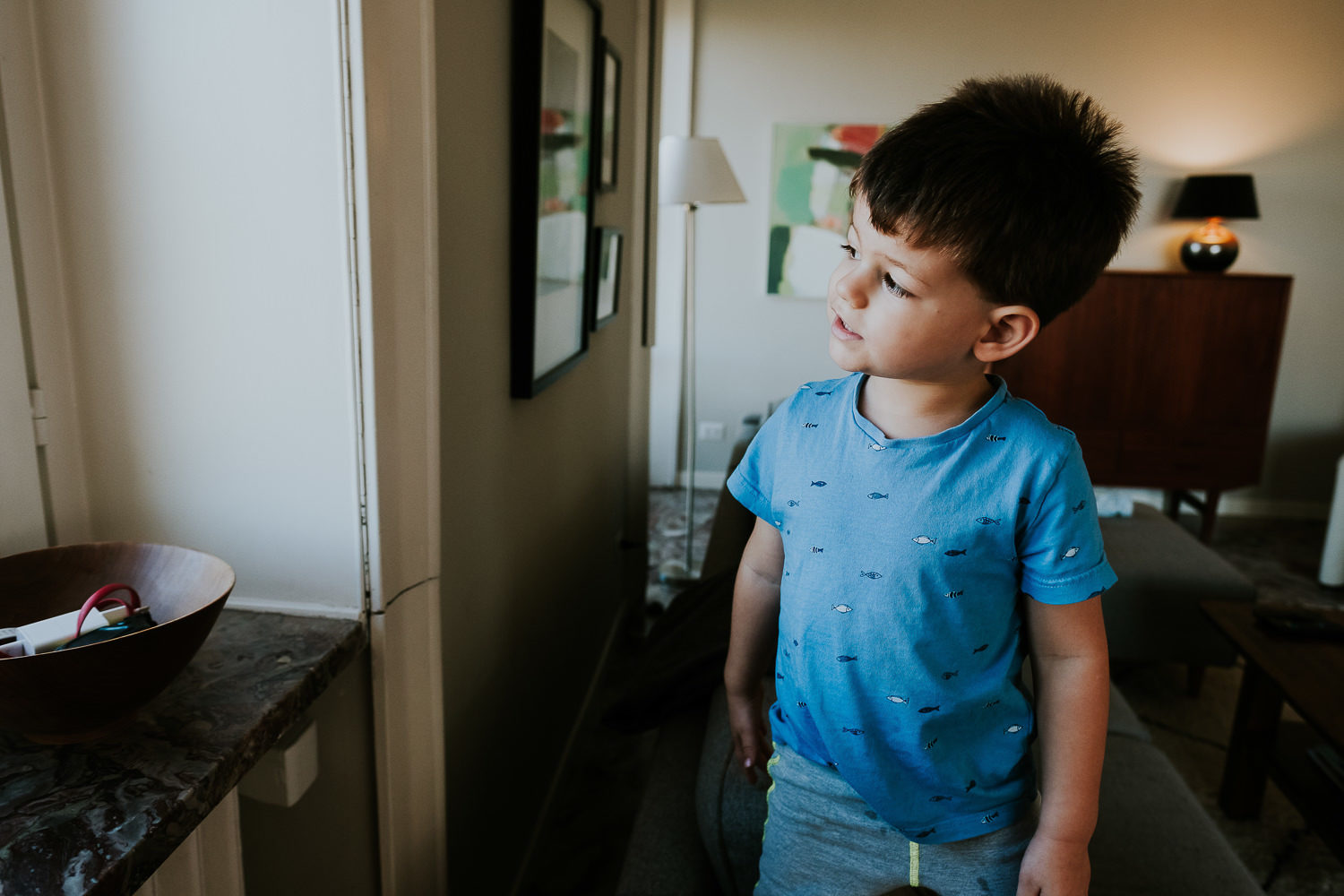 milan family photographer boy looking out of window