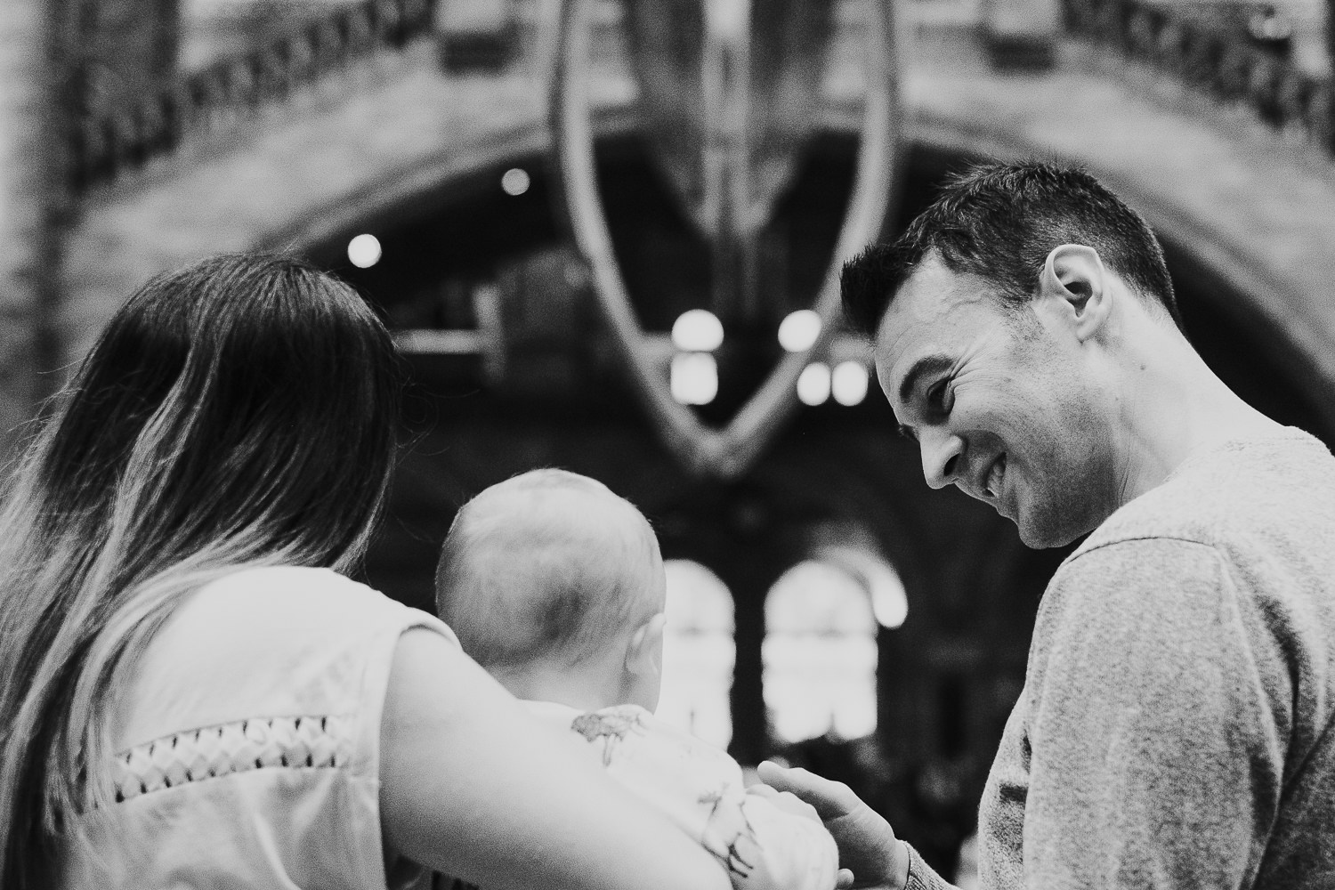 couple with baby son at hintze hall natural history museum with whale skeleton
