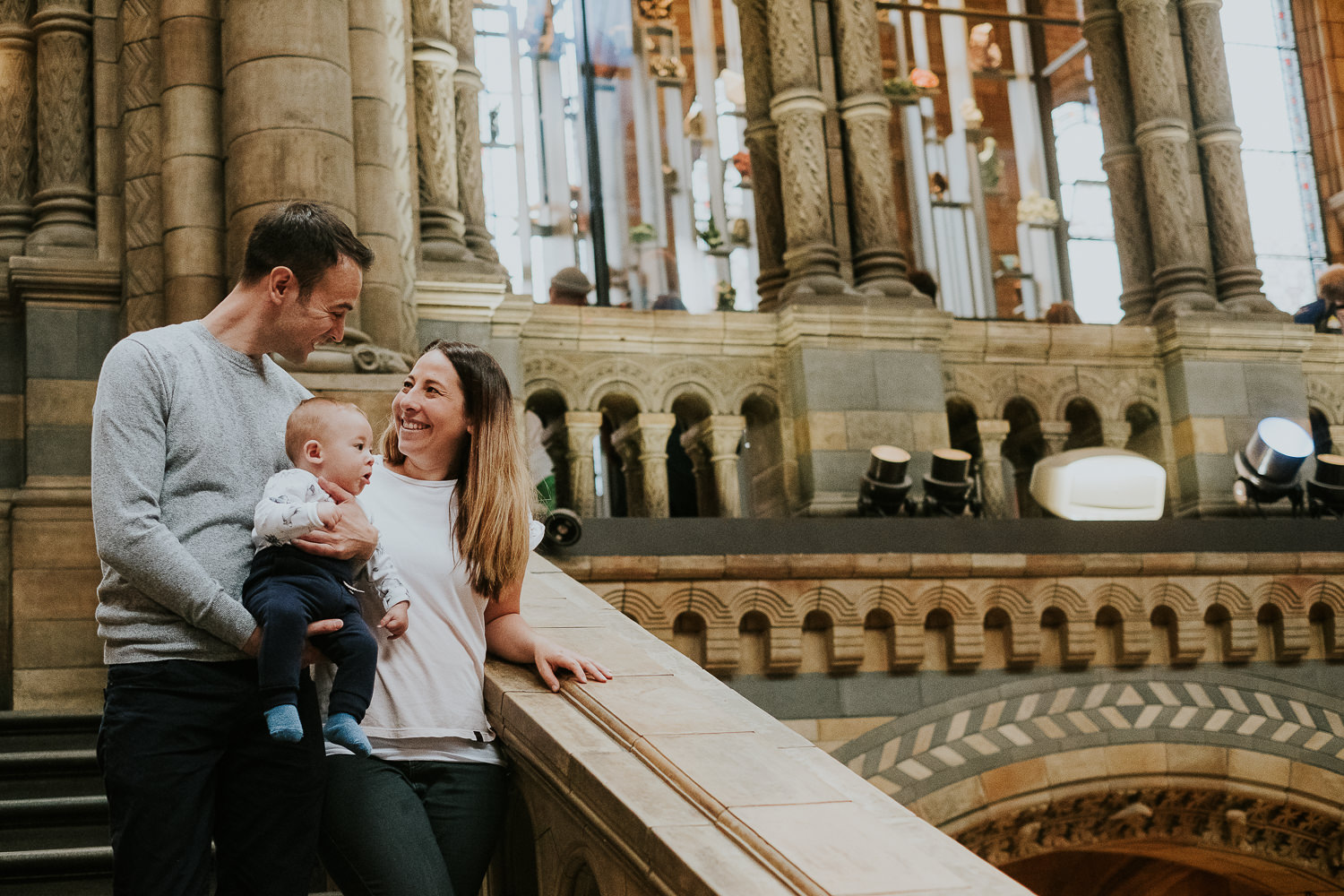 family portrait photograph couple with baby son at the natural history museum family photography hintze hall